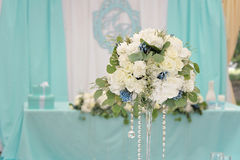 Decoration for the wedding ceremony. Bouquet closeup. A bouquet of flowers closeup in front of wedding table Royalty Free Stock Photos