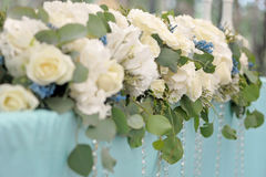 Decoration for the wedding ceremony. Flowers closeup. Table decoration for the wedding ceremony. A bouquet of flowers closeup Stock Photos