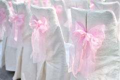 Decoration on wedding chairs pink bow.  Stock Photography