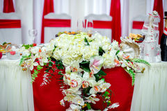 Decoration wedding feast. With red ribbons Stock Photos