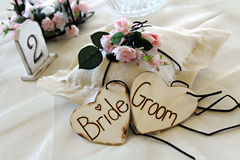 Decoration at wedding reception. Table decoration at wedding reception composed of the two hearts side by side and inscribed with text ' Bride and Groom Stock Images