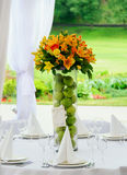 Decoration of wedding table. Bouquet in vase on decorating wedding table Royalty Free Stock Photo