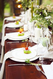 Decoration of wedding table with crystal vases, flowers and appe Stock Photography