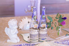 Decoration for wedding table in purple color . Bottle of champag Royalty Free Stock Photo