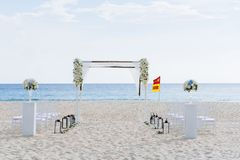 Beach Wedding Venue. The decoration of wedding venue on the beach with the ocean in the background around 5pm before sunset, Simple but romance, at Centara Grand Royalty Free Stock Images