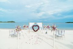 Beach Wedding Venue Samui Thailand. The decoration of wedding venue on the beach with the ocean in the background around 5pm before the sunset, Simple but Royalty Free Stock Photography