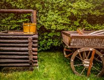 Decoration of a well in wells and a cart of wooden logs in the manor. stock image