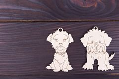 Decoration for a winter holiday. Dogs on dark wooden background. Traditional toys with place for text royalty free stock image