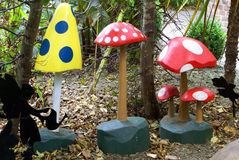 Decoration of wooden mushroom in a garden Royalty Free Stock Photography