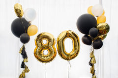 Decoration for 80 years birthday, anniversary. Decoration for birthday, anniversary, celebration of the eight hundred anniversary, white background, gold and Royalty Free Stock Photo