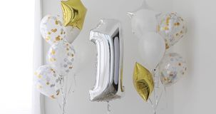 Decoration for 1 years birthday, anniversary. Decoration for birthday, anniversary, celebration of the first 1 year anniversary, white background silver and gold stock footage