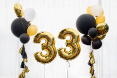 Decoration for 33 years birthday, anniversary. Decoration for birthday, anniversary, celebration of the thirty-third anniversary, white background, gold and stock images