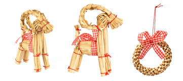 Decorations. Christmas decorations from straw. wreath and goat. each one is shot separately Stock Images