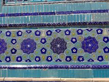Decorations of blue flowers of a wall of a ceramic wall. Uzbekistan. Decorations of blue flowers of a wall of a ceramic wall, Uzbekistan. Blue color. Detail of a stock photo