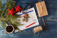 Decorations and calendar with Christmas Day marked out Royalty Free Stock Images