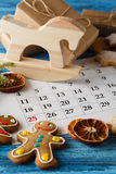 Decorations and calendar with Christmas Day marked out Stock Photography