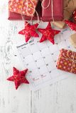 Decorations and calendar with Christmas Day marked out Stock Images