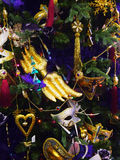 Decorations with carnival masks on the christmas tree Royalty Free Stock Images