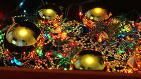 Decorations for celebrating the new year and christmas on a dark background in the box. Man opens a wooden suitcase with decorations for celebrating the new year stock footage