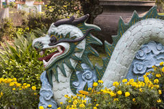 Decorations in Chinese garden. Dragon as a decoration in Chinee garden. According to Chinese believes dragon is protecting people from evil spirits Stock Images