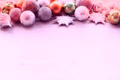 Decorations for Christmas celebration. Christmas balls, snowflakes, decoration on wooden background Stock Image
