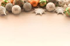 Decorations for Christmas celebration. Christmas balls, snowflakes, decoration on wooden background Royalty Free Stock Photo