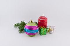 Decorations for Christmas. Christmas decoration with candle and ball on a white background stock photography
