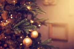 Decorations on a Christmas tree and glare of lights Stock Photography