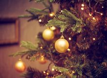 Decorations on a Christmas tree and glare of lights Royalty Free Stock Image