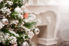 Decorations on a Christmas tree and glare of lights Stock Photo