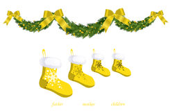 Decorations for fireplace. Yellow xmas sock and ribbons Royalty Free Stock Photo