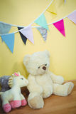 Decorations and fluffy teddies against the wall royalty free stock image