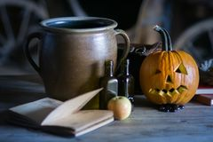 Still life with pumpkin face on halloween in october stock photography