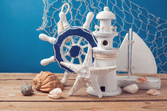 Decorations of marine lifestyle on wooden table over blue background Royalty Free Stock Photo