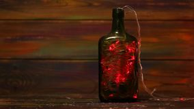 Decorations for the New Year. Garland with flashing lights inside the bottle. Creative solutions stock video