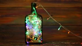 Decorations for the New Year. Garland with flashing lights inside the bottle. stock footage