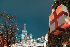 Decorations for New Year and holidays. Christmas balls on tree branches near to St. Basil`s Cathedral on Red square in Royalty Free Stock Images