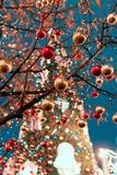 Decorations for New Year and holidays. Christmas balls on tree branches near to St. Basil`s Cathedral on Red square in Royalty Free Stock Photography