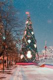 Decorations for New Year and holidays. Christmas balls on tree branches near to St. Basil`s Cathedral on Red square in Royalty Free Stock Photos