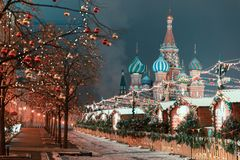 Decorations for New Year and holidays. Christmas balls on tree branches near to St. Basil`s Cathedral on Red square in Stock Images