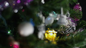 Decorations New Year tree. Loopable defocus stock video footage