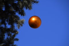 Decorations New Year tree. Tinsel and toys, balls and other decorations on the Christmas Christmas tree standing in the open air Royalty Free Stock Image