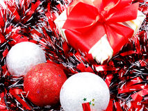 Decorations with red and white tinsel chistmas background Royalty Free Stock Photo