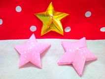 Decorations with ribbon star. Lovely cloths background Stock Photos