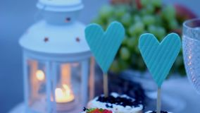 Decorations for a romantic candlelit dinner. candles, lanterns, cakes and fruits for a romantic dinner for two. Decorations for a romantic candlelit dinner stock video footage