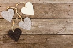Decorations shapes as hearts on wooden background. Four hearts on wooden background Royalty Free Stock Photos