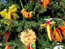 Decorations at Shrovetide, Russia traditions, russian Maslenitsa. Maslenitsa in Russia. Decorations of Slavic holiday. On fir tree are dolls, bagels and festive stock photo