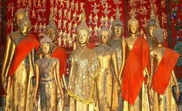 Ancient Buddha statues in Unesco temple Wat Xieng Thong, Luang Prabang, Laos Royalty Free Stock Photography
