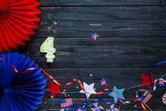 Decorations for 4th of July day of American independence, flag, candles, straws. USA holiday decorations on a wooden background royalty free stock photography
