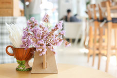 Decorations of Tiny Lilac flowers in vase for interiors of coffee shop Royalty Free Stock Photography